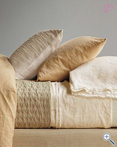 Eileen Fisher rippled cotton coverlet and raw linen sheets.