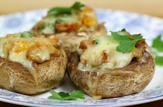 This garlic and cheese stuffed mushrooms recipe is a great choice for parties and they also make great starters. With fragrant garlic and masses of cheese, these easy and delicious stuffed Portobello mushrooms make the perfect canapés.
