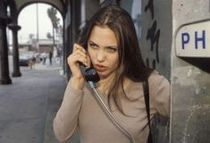 19 year old Angelina Jolie on the phone