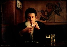 Shane MacGowan (Pogues): In blood and death 'neath a screaming sky / I lay down on the ground / And the arms and legs of other men / Were scattered all around / Some cursed, some prayed, some prayed then cursed / Then prayed and bled some more...