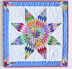 Rainy Day Star by Lorraine Olsen, a miniature quilt in her book, Little Lone Star Quilts.