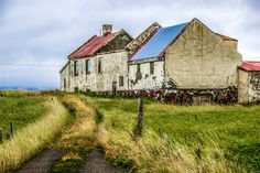 A beautiful, crumbling farm house in a field of grasses outside of Akranes, Iceland. || #AlexTonettiPhotography #Photography