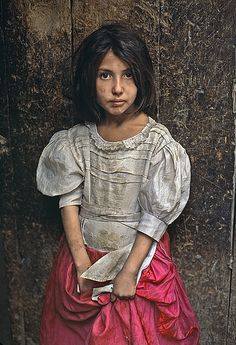 Bid now on Girl in Pink Skirt, Kabul, Afghanistan by Steve McCurry. View a wide Variety of artworks by Steve McCurry, now available for sale on artnet Auctions. Steve Mccurry Portraits, Steve Mccurry Photos, We Are The World, People Of The World, Foto Portrait, Portrait Photography, Photography Tips, Street Photography, Landscape Photography
