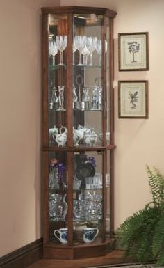 corner curio cabinet - Mine looks very similar to this. Got it over the weekend. Cant wait to put it together. Think we should work on our dining room this weekend? @darrenstearns