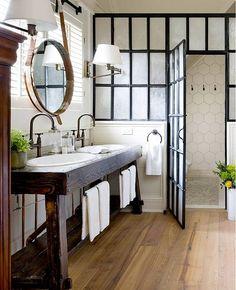 Masculine cottage bath. Steel factory shower door reclaimed wood vanity leather mirror large scale honeycomb tile