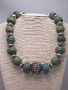 by Julianna Lindsay | Ancient Hebron beads combined with a Yemeni focal bead and contemporary silver alloy beads from Mali