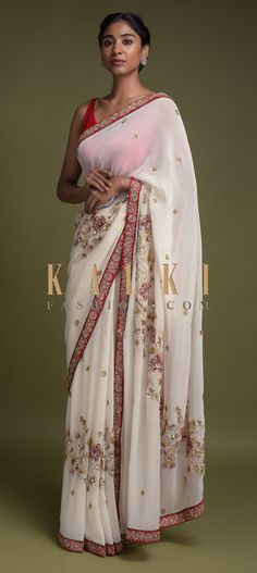 Daisy white saree in georgette with red embroidered border. Adorned with sequins, pita zari and velvet patchwork in floral motifs. Bollywood Outfits, Bollywood Saree, Bollywood Fashion, Lehenga Style Saree, Saree Look, Indian Attire, Indian Outfits, Indian Wear, Red And White Saree