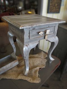 Distressed Side Table with Assorted Hardware