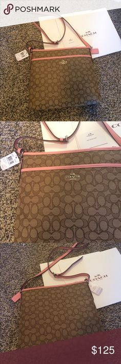 💕Coach File Cross Body Bag NWT ‼️MUST SELL‼️ New with tags Coach cross body file bag! Fabric but water repellent. Pink leather trim and adjustable strap. Has front folder pocket on exterior. Interior has zipper compartment. Perfect size for suiting all needs. Comes with box. Reasonable offers are welcome Coach Bags