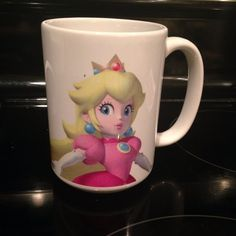 Princess Peach Mug Collectors Item from Nintendo World, used a few times, but still in excellent condition. Other