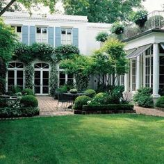 *** house exterior - red brick patio, divided with raised panters and lots of green plants, trees and grasses*** Outdoor Rooms, Outdoor Gardens, Outdoor Living, Courtyard Gardens, Modern Gardens, Longwood Gardens, Small Gardens, Beautiful Gardens, Beautiful Homes