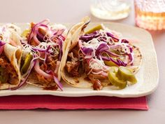 Recipe of the Day: Rachael's Pork Tacos with a Kick         Rachael braises pork in a spicy bath of chiles and beer, then builds the tacos with crunchy slaw and cool crumbled cheese to balance the heat.         #RecipeOfTheDay