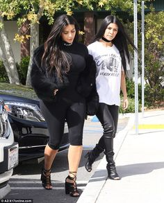 Stylish siblings: Kourtney wore tight leather leggings and boots
