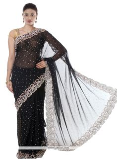 This black faux chiffon designer saree is accenting the charming feeling. The embroidered, patch border and resham work appears to be chic and fantastic for any function. Comes with matching blouse. (...