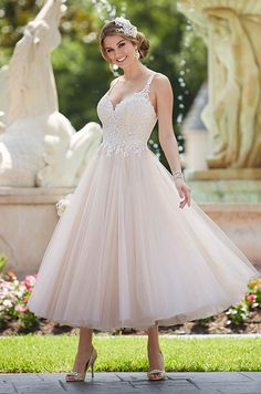 This Stella York tea-length is featuring beaded lace bodice and tulle skirt.