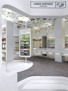 225 Linden Apotheke Interior Design by Ippolito Fleitz Group look at that ceiling! Design Exterior, Shop Interior Design, Retail Design, Store Design, Pharmacy Store, Budget Planer, Cosmetic Shop, Bath And Beyond Coupon, Retail Interior