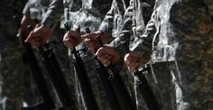 U.S. soldiers hold their rifles in silence during a Memorial Day observance ceremony in Afghanistan.