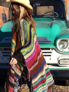 This statement piece WILL become your favorite go-to item in your closet. People are going to notice you when you wear it. They WILL come up to you, even complete strangers, and comment on it, some may even want to touch you. Just saying.... get used to it. Each poncho is one of a kind, no two are alike, and as you can see, I am only mildly obsessed with color. They are made from all kinds of yarns and fibers and I use only yarns that are soft to the touch, especially around the neck. There…