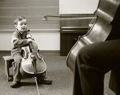 A very young #cellist with his small #cello taking a class of #music