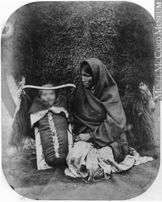 Chippewa woman with child on cradle board, MB, 1858  Humphrey Lloyd Hime  1858, 19th century  Silver salts on paper mounted on paper - Albumen process  17 x 13 cm