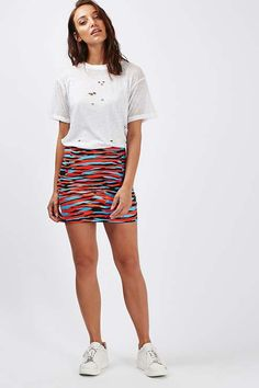 d54515fa7366 Bold prints take centre stage with this multi coloured mini skirt with a  tiger print.