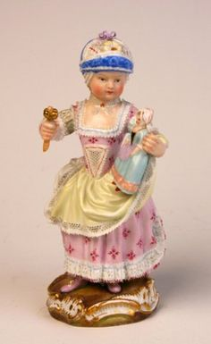Meissen figure of a girl holding a rattle