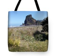 Looking towards majestic Lion Rock on Piha Beach. This now rather famous beach is only about 40 minutes comfortable drive from Auckland city. You'll see magnificent surf and spectacular coastal views. If you're keen you can catch some pretty amazing rides!