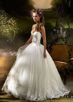 2010 bridal dress collection from Lazaro - Ivory English net formal bridal ball gown, sweetheart neckline, silk Mikado yoke bodice with   vintage fresh water pearl ivory ribbon belt at natural waist, full gathered embroidered English net skirt with sequin tulle underlay, sweep train.