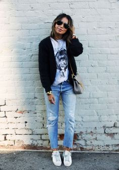 A combination of a white graphic tee and denim... - Street Style