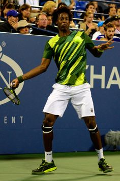 Gael Monfils of France in green and yellow at the US Open.  #tennis