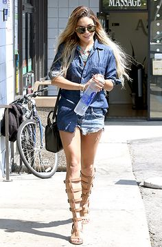 Vanessa Hudgens flashed her toned gams in tiny denim cutoffs paired with an oversized button-up top in Santa Monica on May 23. Comfortable gladiator sandals by Chinese Laundry completed the look.