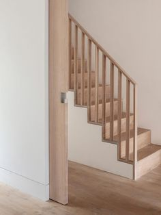 Completed by the Al-Jawad Pike architecture firm, this light concrete and wood contemporary house extension beautifully complements a Victorian house. New Staircase, Staircase Railings, Wood Stairs, House Stairs, Banisters, Wood Stair Handrail, Ramp Stairs, Narrow Staircase, Spiral Staircases
