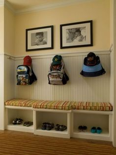 Looks like it was a closet space converted to a mini mudroom.  I like the wainscoting.