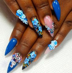 Striking blue stiletto shaped nails with nail art and diamonte gemstones