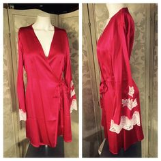 "VICTORIA'S SECRET Red SILK & White Lace Short Robe Gorgeous VICTORIA'S SECRET Red SILK and White Lace Short Robe with belt. Bell sleeves are trimmed in a white lace Appliqué. Measured flat: shoulder to bottom hem 35""; long bell sleeves 25"" from shoulder; 18"" across shoulders. Collar loop for hanging. Worn once. In excellent preowned condition. Smoke-free home. Victoria's Secret Intimates & Sleepwear Robes"