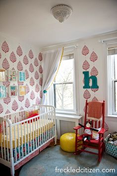 Bright, cheery eclectic nursery featuring fab stenciled walls