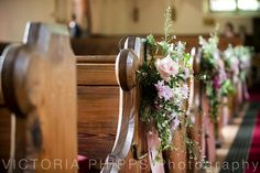 Pink flow­ers dec­o­rate the pew ends Church Pew Flowers, Aisle Flowers, Wedding Pews, Wedding Ceremony Flowers, Pew Decorations, Wedding Flower Decorations, Old World Wedding, Pew Ends, Wedding Blog