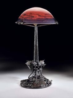 A WROUGHT-IRON AND TABLE LAMP 20th century, with frosted glass shade marked with acid-stamp Muller Fres Luneville   Christie's