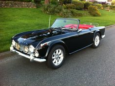 1965 Triumph TR4a.  I couldn't find a powder blue one like I owned for a short time around 1966-67.  This black one is far more beautiful than the blue version.