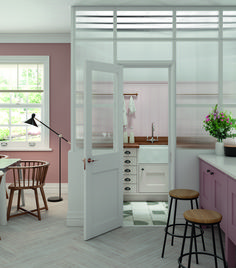 The semi-glazed surround of this pretty pink utility room shuts out sound but still lets light in.The Solva Shaker range from Masterclass Kitchens starts from £7500.