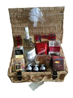 Presented in a luxury wicker basket with lid and real leather straps. Our Luxury Wedding/Anniversary/Engagement/New Home hampers are a perfect gift for the happy couple. Packed full of scrumptious treats with either classic Italian sparkling Prosecco Wine or Belvoir Elderflower Presse and beautifully presented with a white bow and gift tag which are included in the price. Christmas Gift Baskets, Christmas Gift Decorations, Christmas Gifts, Wicker Basket With Lid, Wicker Baskets, Wedding Anniversary, Anniversary Gifts, Luxury Hampers