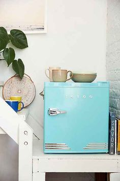Upgrade your dorm decor with this too cool mini refrigerator. Decorating Small Spaces, Decorating On A Budget, Interior Decorating, Stainless Steel Mini Fridge, Anthropologie, Back To School Essentials, Kitchen Collection, Affordable Home Decor, Small Rooms