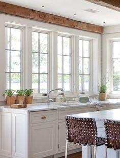 white cabinets + rustic beams