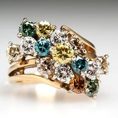 Like: different colored stones, floral cluster of stones. Dislike: clamps, though they don't look as bad clustered together.
