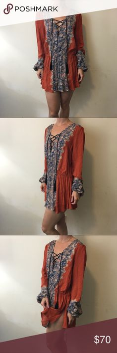 Free People Orange Decorative Tassel Tunic Shirt Free People Tunic with a gorgeous bright orange and a decorative middle, long sleeves and tassels in front Neck. Not lined and has slits on either side. Free People Tops