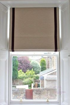 Ideas for dressing a traditional sash window. Neutral greige roman blind with purple braid trimming sitting inside the window recess at an Edinburgh sash window. #romanblind #sashwindow #victorianwindow