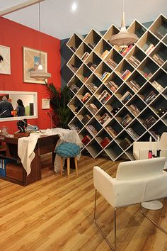 Diagonal bookshelves create a really nice rhythm on this wall