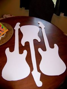 DIY guitar shaped centerpieces $0.50 each! OR have the kids decorate their own guitar to take home!