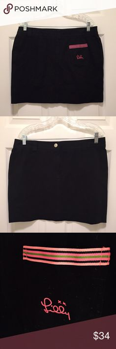 Lilly Pulitzer NWOT Embroidered Black Mini Skirt Lilly Pulitzer Size 14 (*RUNS SMALL*) Black Mini Skirt. Embroidered back pocket with Lilly signature logo and striped ribbon embellishment. Snap/zipper closure. Never worn it but it has been through several moves, so there has been normal shuffling around of the skirt. But no wear & tear! White tag. Cotton/spandex blend, so pretty stretchy. Lilly Pulitzer Skirts Mini