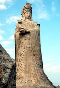 """Mazu statue at her birthplace, Meizhou Island, Fujian.  Mazu is a Chinese Goddess of the ocean and Her name means """"Mother Ancestor.""""  She is traditionally honored on the twenty-third day of the third lunar month of the Chinese calendar.  (mid-April to early May)"""